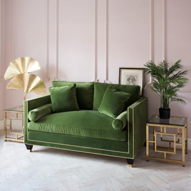 green sofa with pink walls.jpg