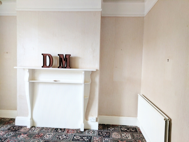 before-dated-living-room-fireplace