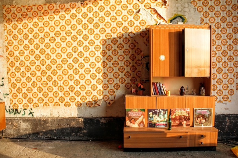 1970s style wallpaper and antique furniture
