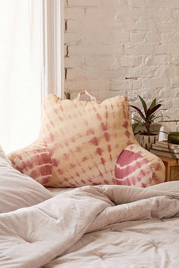 The cream and pink tie die seventies decor pillow